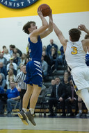 Varsity Basketball Drops GCL South Opener